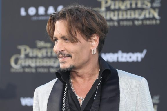 """HOLLYWOOD, CA - MAY 18: Actor Johnny Depp at the Premiere of Disney's and Jerry Bruckheimer Films' """"Pirates of the Caribbean: Dead Men Tell No Tales,"""" at the Dolby Theatre in Hollywood, CA with Johnny Depp as the one-and-only Captain Jack in a rollicking new tale of the high seas infused with the elements of fantasy, humor and action that have resulted in an international phenomenon for the past 13 years. May 18, 2017 in Hollywood, California. (Photo by Rich Polk/Getty Images for Disney) *** Local Caption *** Johnny Depp"""