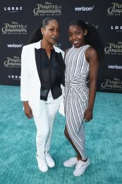 """HOLLYWOOD, CA - MAY 18: Actor Tichina Arnold (L) and Alijah Kai Haggins at the Premiere of Disney's and Jerry Bruckheimer Films' """"Pirates of the Caribbean: Dead Men Tell No Tales,"""" at the Dolby Theatre in Hollywood, CA with Johnny Depp as the one-and-only Captain Jack in a rollicking new tale of the high seas infused with the elements of fantasy, humor and action that have resulted in an international phenomenon for the past 13 years. May 18, 2017 in Hollywood, California. (Photo by Rich Polk/Getty Images for Disney) *** Local Caption *** Tichina Arnold; Alijah Kai Haggins"""