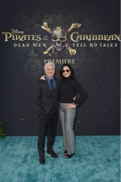 """HOLLYWOOD, CA - MAY 18: Executive producer Brigham Taylor (L) and guest at the Premiere of Disney's and Jerry Bruckheimer Films' """"Pirates of the Caribbean: Dead Men Tell No Tales,"""" at the Dolby Theatre in Hollywood, CA with Johnny Depp as the one-and-only Captain Jack in a rollicking new tale of the high seas infused with the elements of fantasy, humor and action that have resulted in an international phenomenon for the past 13 years. May 18, 2017 in Hollywood, California. (Photo by Marc Flores/Getty Images for Disney) *** Local Caption *** Brigham Taylor"""