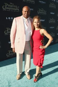 """HOLLYWOOD, CA - MAY 18: Actor Chi McBride (L) and Julissa McBride at the Premiere of Disney's and Jerry Bruckheimer Films' """"Pirates of the Caribbean: Dead Men Tell No Tales,"""" at the Dolby Theatre in Hollywood, CA with Johnny Depp as the one-and-only Captain Jack in a rollicking new tale of the high seas infused with the elements of fantasy, humor and action that have resulted in an international phenomenon for the past 13 years. May 18, 2017 in Hollywood, California. (Photo by Rich Polk/Getty Images for Disney) *** Local Caption *** Chi McBride; Julissa McBride"""