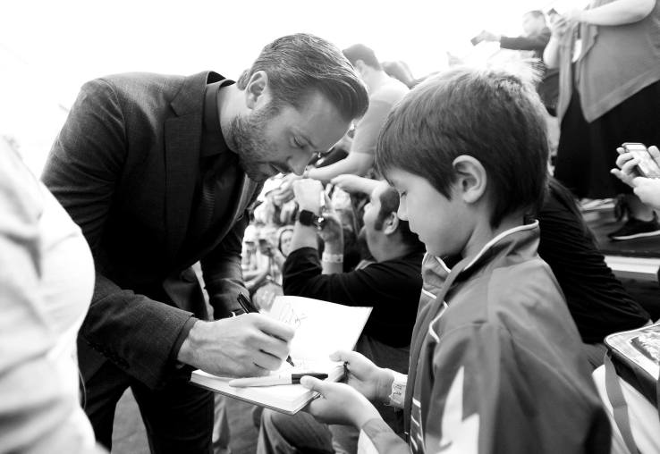 """ANAHEIM, CA - JUNE 10: (EDITORS NOTE: Image has been shot in black and white. Color version not available.) Actor Armie Hammer (L) signs autographs at the World Premiere of Disney/Pixarís ìCars 3"""" at the Anaheim Convention Center on June 10, 2017 in Anaheim, California. (Photo by Charley Gallay/Getty Images for Disney) *** Local Caption *** Armie Hammer"""