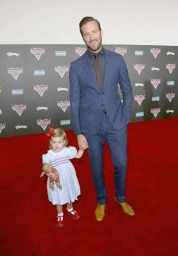 """ANAHEIM, CA - JUNE 10: Harper Hammer (L) and actor Armie Hammer pose at the World Premiere of Disney/Pixarís ìCars 3"""" at the Anaheim Convention Center on June 10, 2017 in Anaheim, California. (Photo by Jesse Grant/Getty Images for Disney) *** Local Caption *** Armie Hammer;Harper Hammer"""