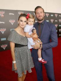 "ANAHEIM, CA - JUNE 10: (L-R) Actor Elizabeth Chambers, Harper Hammer, and actor Armie Hammer pose at the World Premiere of Disney/Pixarís ìCars 3"" at the Anaheim Convention Center on June 10, 2017 in Anaheim, California. (Photo by Jesse Grant/Getty Images for Disney) *** Local Caption *** Armie Hammer;Harper Hammer;Elizabeth Chambers"