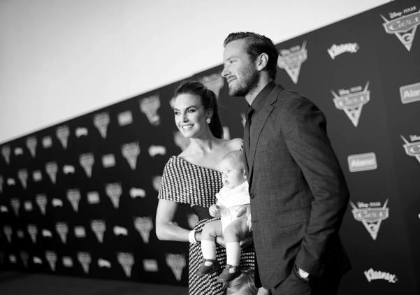 """ANAHEIM, CA - JUNE 10: (EDITORS NOTE: Image has been shot in black and white. Color version not available.) (L-R) Actor Elizabeth Chambers, Ford Hammer, and actor Armie Hammer pose at the World Premiere of Disney/Pixarís ìCars 3"""" at the Anaheim Convention Center on June 10, 2017 in Anaheim, California. (Photo by Charley Gallay/Getty Images for Disney) *** Local Caption *** Armie Hammer;Elizabeth Chambers;Ford Hammer"""