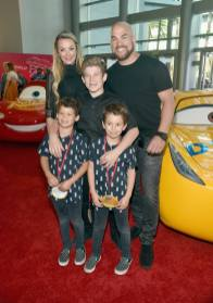 "ANAHEIM, CA - JUNE 10: Actor Amber Nichole Miller (back L), retired mixed martial artist Tito Ortiz (back R), and guests pose at the World Premiere of Disney/Pixarís ìCars 3"" at the Anaheim Convention Center on June 10, 2017 in Anaheim, California. (Photo by Alberto E. Rodriguez/Getty Images for Disney) *** Local Caption *** Amber Nichole Miller;Tito Ortiz"