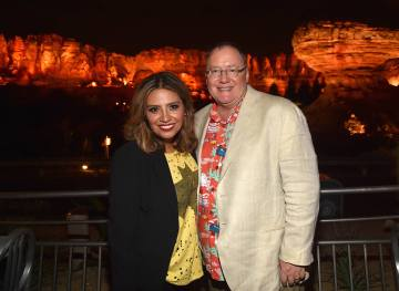 ANAHEIM, CA - JUNE 10: Actor Cristela Alonzo (L) and executive producer John Lasseter pose at the after party for the World Premiere of Disney/Pixarís ìCars 3î at Cars Land at Disney California Adventure in Anaheim, CA. (Photo by Alberto E. Rodriguez/Getty Images for Disney) *** Local Caption *** John Lasseter;Cristela Alonzo