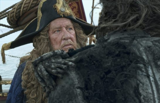 """""""PIRATES OF THE CARIBBEAN: DEAD MEN TELL NO TALES""""..The villainous Captain Salazar (Javier Bardem) pursues Jack Sparrow (Johnny Depp) as he searches for the trident used by Poseidon...Pictured: Geoffrey Rush (Barbossa)..Ph: Film Frame..© Disney Enterprises, Inc. All Rights Reserved."""