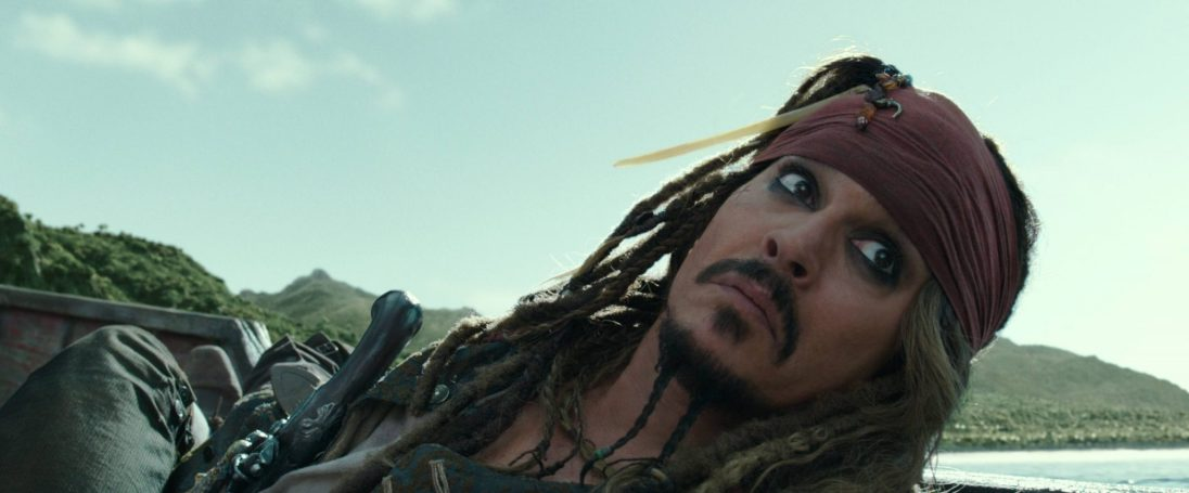 """PIRATES OF THE CARIBBEAN: DEAD MEN TELL NO TALES""..The villainous Captain Salazar (Javier Bardem) pursues Jack Sparrow (Johnny Depp) as he searches for the trident used by Poseidon..Pictured: Captain Jack Sparrow (Johnny Depp)..Ph: Film Frame..© Disney Enterprises, Inc. All Rights Reserved."