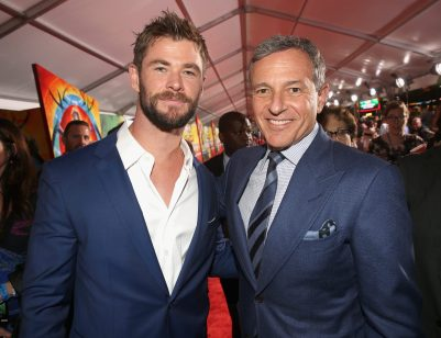 "HOLLYWOOD, CA - OCTOBER 10: Actor Chris Hemsworth (L) and The Walt Disney Company Chairman and CEO, Bob Iger at The World Premiere of Marvel Studios' ""Thor: Ragnarok"" at the El Capitan Theatre on October 10, 2017 in Hollywood, California. (Photo by Jesse Grant/Getty Images for Disney) *** Local Caption *** Chris Hemsworth; Bob Iger"