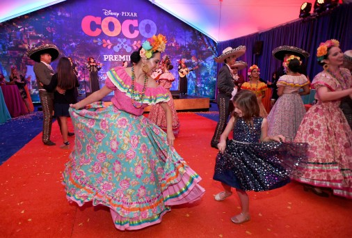"""HOLLYWOOD, CA - NOVEMBER 08: Dancers perform at the U.S. Premiere of Disney-Pixarís """"Coco"""" at the El Capitan Theatre on November 8, 2017, in Hollywood, California. (Photo by Charley Gallay/Getty Images for Disney)"""