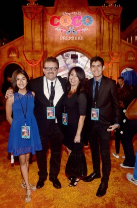 """HOLLYWOOD, CA - NOVEMBER 08: Artist and film consultant Lalo Alcaraz (2nd L) and guests at the U.S. Premiere of Disney-Pixarís """"Coco"""" at the El Capitan Theatre on November 8, 2017, in Hollywood, California. (Photo by Alberto E. Rodriguez/Getty Images for Disney) *** Local Caption *** Lalo Alcaraz"""
