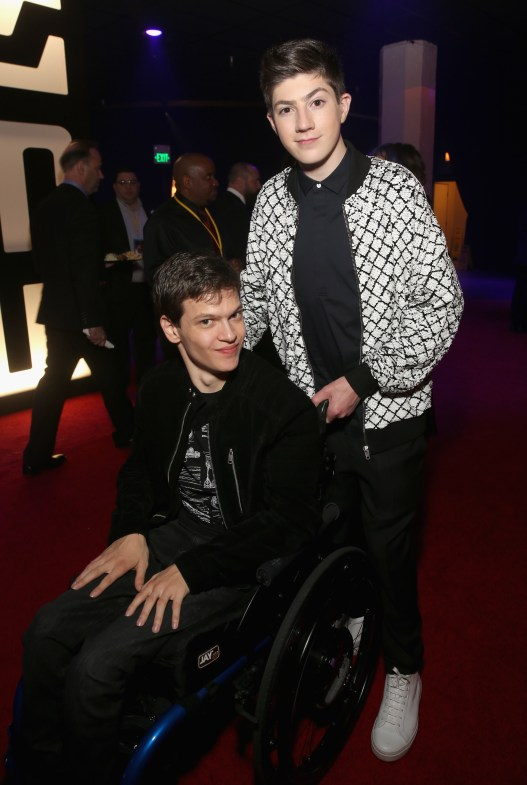 LOS ANGELES, CA - DECEMBER 09: Actors Micah Fowler (L) and Mason Cook at Star Wars: The Last Jedi Premiere at The Shrine Auditorium on December 9, 2017 in Los Angeles, California. (Photo by Jesse Grant/Getty Images for Disney) *** Local Caption *** Mason Cook; Micah Fowler