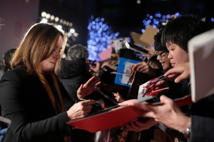 TOKYO, JAPAN - DECEMBER 06: Producer Kathleen Kennedy signs autograph for fans during the 'Star Wars: The Last Jedi' Japan Premiere & Red Carpet at Roppongi Hills on December 6, 2017 in Tokyo, Japan. (Photo by Christopher Jue/Getty Images for Disney) *** Local Caption *** Kathleen Kennedy