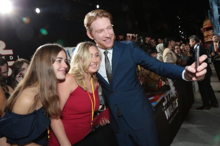 Domhnall Gleeson takes a selfie with fans on the red carpet for the world premiere of LucasfilmÕs Star Wars: The Last Jedi at the Shrine Auditorium in Los Angeles, December 9, 2017..(Photo: Alex J. Berliner / ABImages )
