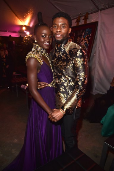 HOLLYWOOD, CA - JANUARY 29: Actors Lupita Nyong'o (L) and Chadwick Boseman at the Los Angeles World Premiere of Marvel Studios' BLACK PANTHER at Dolby Theatre on January 29, 2018 in Hollywood, California. (Photo by Alberto E. Rodriguez/Getty Images for Disney) *** Local Caption *** Lupita Nyong'o; Chadwick Boseman