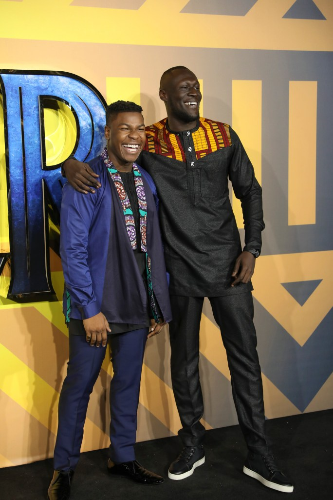 "LONDON, ENGLAND - FEBRUARY 08: John Boyega and Stormzy attend the European Premiere of Marvel Studios' ""Black Panther"" at the Eventim Apollo, Hammersmith on February 8, 2018 in London, England. (Photo by Gareth Cattermole/Getty Images for Disney) *** Local Caption *** John Boyega; Stormzy"
