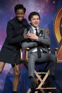 LONDON, ENGLAND - APRIL 08: Letitia Wright (L) and Tom Holland (R) attend the UK Fan Event to celebrate the release of Marvel Studios' 'Avengers: Infinity War' at The London Television Centre on April 8, 2018 in London, England. (Photo by Gareth Cattermole/Gareth Cattermole/Getty Images for Disney)
