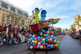 """CHARACTERS FROM 'INSIDE OUT' JOIN 'PIXAR PLAY PARADE'ANAHEIM, Calif.)— """"Pixar Play Parade"""" returns to the Disneyland Resort, this time to Disneyland Park for the limited-time Pixar Fest celebration. The delightful parade brings even more fan-favorite Pixar stories to life with the addition of three new story elements. From the Pixar film, """"Inside Out"""" Joy and Sadness appear perched atop colorful memory orbs as they take flight aboard Riley's rocket wagon, with Bing Bong cheering them on. (Rob Sparacio/Disneyland Resort)"""