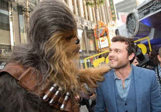 """Chewbacca greets Alden Enrenreich at the world premiere of """"Solo: A Star Wars Story"""" in Hollywood on May 10, 2018..(Photo: Alex J. Berliner/ABImages)."""
