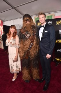 HOLLYWOOD, CA - MAY 10: Milla Pohjasvaara (L) and Actor Joonas Suotamo pose with Chewbacca at the world premiere of ìSolo: A Star Wars Storyî in Hollywood on May 10, 2018. (Photo by Alberto E. Rodriguez/Getty Images for Disney) *** Local Caption *** Milla Pohjasvaara; Joonas Suotamo