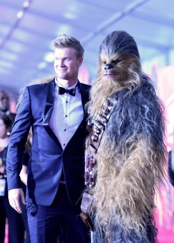 HOLLYWOOD, CA - MAY 10: Actor Joonas Suotamo (L) and Chewbacca attend the world premiere of ìSolo: A Star Wars Storyî in Hollywood on May 10, 2018. (Photo by Alberto E. Rodriguez/Getty Images for Disney) *** Local Caption *** Joonas Suotamo; Chewbacca