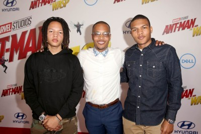 """HOLLYWOOD, CA - JUNE 25: (L-R) Domani Harris, Actor Tip """"T.I."""" Harris and Messiah Harris attend the Los Angeles Global Premiere for Marvel Studios' """"Ant-Man And The Wasp"""" at the El Capitan Theatre on June 25, 2018 in Hollywood, California. (Photo by Jesse Grant/Getty Images for Disney) *** Local Caption *** Domani Harris; Tip """"T.I."""" Harris; Messiah Harris"""
