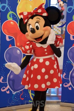 Minnie poses for the Minnie Walk photo booth