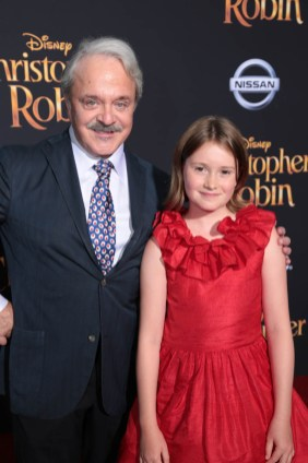 "Jim Cummings and Bronte Carmichael pose together at the world premiere of Disney's ""Christopher Robin"" at the Main Theater on the Walt Disney Studios lot in Burbank, CA on July 30, 2018. (Photo: Alex J. Berliner/ABImages)"