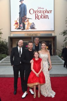 BURBANK, CA - JULY 30: (L-R) Director Marc Forster, actors Ewan McGregor, Brad Garrett, Bronte Carmichael and Hayley Atwell attend the world premiere of Disney's 'Christopher Robin' at the Main Theater on the Walt Disney Studios lot in Burbank, CA on July 30, 2018. (Photo by Alberto E. Rodriguez/Getty Images for Disney) *** Local Caption *** Marc Forster; Ewan McGregor; Brad Garrett; Bronte Carmichael; Hayley Atwell