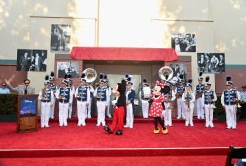 BURBANK, CA - JULY 30: Songwriter Richard M. Sherman, Mickey Mouse, Minnie Mouse and the Disneyland Band attend the dedication and re-naming of the historic Orchestra Stage, now the Sherman Brothers Stage A, on the Disney Burbank lot prior to the world premiere of Disney's 'Christopher Robin' at the studio's Main Theater, on July 30, 2018. (Photo by Alberto E. Rodriguez/Getty Images for Disney) *** Local Caption *** Richard M. Sherman; Minnie Mouse; Mickey Mouse; Disneyland Band
