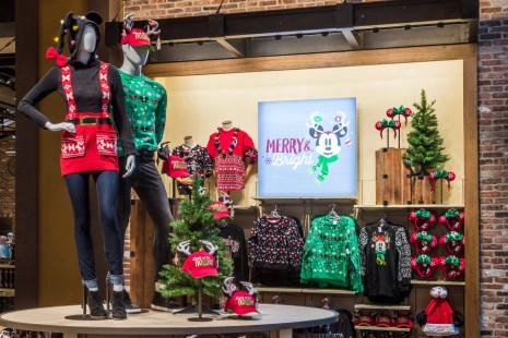 """During the holiday season, holiday wear including """"ugly sweaters"""" with patterns inspired by Disney Parks can be found throughout Disneyland Resort in California and Walt Disney World Resort in Florida. Other seasonal wear includes spirit jerseys, hoodies with ears and patterned crew socks with fun knit details. (Joshua Sudock/Disneyland Resort)"""