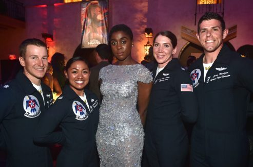 "HOLLYWOOD, CA - MARCH 04: Actor Lashana Lynch (C) poses with Air Force Thunderbirds during the Los Angeles World Premiere of Marvel Studios' ""Captain Marvel"" at Dolby Theatre on March 4, 2019 in Hollywood, California. (Photo by Alberto E. Rodriguez/Getty Images for Disney) *** Local Caption *** Lashana Lynch"