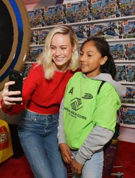 ANAHEIM, CA - APRIL 05: Brie Larson (L) and guest attend Avengers Universe Unites, a charity event to celebrate the donation of more than $5 million in cash and toys to nonprofits supporting children with critical illnesses, at Disney California Adventure Park on April 5, 2019 in Anaheim, California. (Photo by Emma McIntyre/Getty Images for Disney) *** Local Caption *** Brie Larson