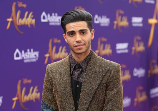 """LOS ANGELES, CA - MAY 21: Mena Massoud attends the World Premiere of Disney's """"Aladdin"""" at the El Capitan Theater in Hollywood CA on May 21, 2019, in the culmination of the film's Magic Carpet World Tour with stops in Paris, London, Berlin, Tokyo, Mexico City and Amman, Jordan. (Photo by Jesse Grant/Getty Images for Disney) *** Local Caption *** Mena Massoud"""