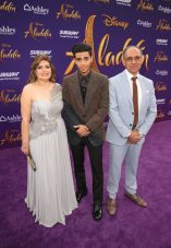 """LOS ANGELES, CA - MAY 21: Mena Massoud (C) and guests attend the World Premiere of Disney's """"Aladdin"""" at the El Capitan Theater in Hollywood CA on May 21, 2019, in the culmination of the film's Magic Carpet World Tour with stops in Paris, London, Berlin, Tokyo, Mexico City and Amman, Jordan. (Photo by Jesse Grant/Getty Images for Disney) *** Local Caption *** Mena Massoud"""