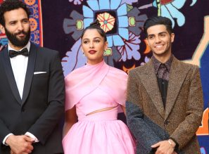 """LOS ANGELES, CA - MAY 21: (L-R) Marwan Kenzari, Naomi Scott and Mena Massoud attend the World Premiere of Disney's """"Aladdin"""" at the El Capitan Theater in Hollywood CA on May 21, 2019, in the culmination of the film's Magic Carpet World Tour with stops in Paris, London, Berlin, Tokyo, Mexico City and Amman, Jordan. (Photo by Jesse Grant/Getty Images for Disney) *** Local Caption *** Marwan Kenzari; Naomi Scott; Mena Massoud"""