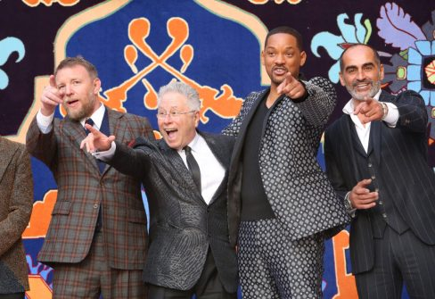 """LOS ANGELES, CA - MAY 21: (L-R) Director Guy Ritchie, Composer Alan Menken, Will Smith and Navid Negahban attend the World Premiere of Disney's """"Aladdin"""" at the El Capitan Theater in Hollywood CA on May 21, 2019, in the culmination of the film's Magic Carpet World Tour with stops in Paris, London, Berlin, Tokyo, Mexico City and Amman, Jordan. (Photo by Jesse Grant/Getty Images for Disney) *** Local Caption *** Guy Ritchie; Alan Menken; Will Smith; Navid Negahban"""