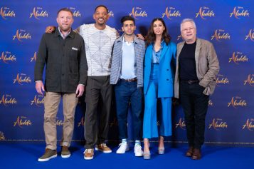 "Guy Ritchie, Will Smith, Mena Massoud, Naomi Scott and Alan Menken attend the photo call to celebrate the release of Disney's ""Aladdin"" on May 10th in London, UK"