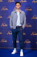 """Mena Massoud attends the photo call to celebrate the release of Disney's """"Aladdin"""" on May 10th in London, UK"""