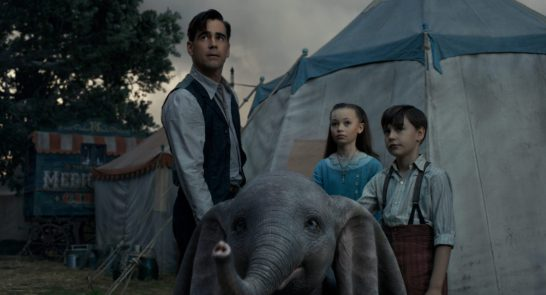 """SPECIAL ASSIGNMENT - In director Tim Burton's all-new live-action adventure """"Dumbo,"""" former circus star Holt Farrier (Colin Farrell) and his children Milly (Nico Parker) and Joe (Finley Hobbins) are charged with caring for a newborn elephant whose oversized ears make him a laughingstock in an already struggling circus. Expanding on the beloved classic story where differences are celebrated, family is cherished and dreams take flight, """"Dumbo"""" flies into theaters on March 29, 2019. ©2018 Disney Enterprises, Inc. All Rights Reserved."""