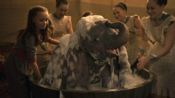 """BATHTIME -- In Disney's live-action reimagining of """"Dumbo,"""" Milly Farrier—the daughter of a former circus star charged with caring for a newborn elephant—quickly embraces the newest member of their circus family. Featuring Nico Parker as Milly, """"Dumbo"""" opens in U.S. theaters on March 29, 2019...© 2019 Disney Enterprises, Inc. All Rights Reserved."""