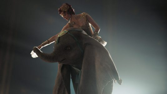 """PARTNERS -- In Disney's live-action reimagining of """"Dumbo,"""" accomplished aerialist Colette Marchant is paired with a flying elephant named Dumbo in a new act at a state-of-the-art amusement park called Dreamland. Starring Eva Green as Colette, """"Dumbo"""" opens in U.S. theaters on March 29, 2019...© 2019 Disney Enterprises, Inc. All Rights Reserved.."""