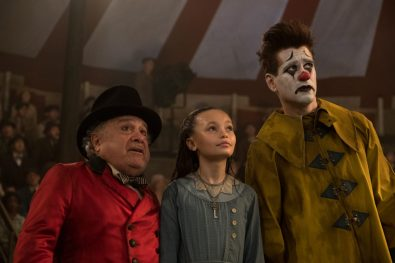 "CLOWNING AROUND -- In Tim Burton's all-new, live-action reimagining of ""Dumbo,"" circus owner Max Medici (Danny DeVito) calls on former circus star Holt Farrier (Colin Farrell) to care for a newborn elephant whose oversized ears make him a laughingstock in an already struggling circus. Holt ultimately takes his task very seriously—even donning a clown suit to help the flying elephant as he emerges as a star. Daughter Milly (Nico Parker) just might be Dumbo's biggest fan. ""Dumbo"" flies into theaters on March 29, 2019. Photo by Jay Maidment. © 2018 Disney Enterprises, Inc. All Rights Reserved."