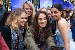 """Naomi Scott takes a selfie with a fan at the European Gala Screening of Disney's """"Aladdin"""" on May 9th at London's ODEON Luxe in Leicester Square, London UK."""