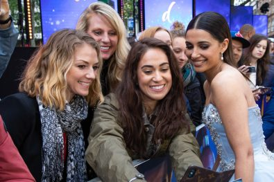"Naomi Scott takes a selfie with a fan at the European Gala Screening of Disney's ""Aladdin"" on May 9th at London's ODEON Luxe in Leicester Square, London UK."