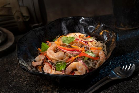 Innovative and creative eats from around the galaxy will be available at Star Wars: GalaxyÕs Edge when it opens May 31, 2019, at Disneyland Park in Anaheim, Calif., and Aug. 29, 2019, at Disney's Hollywood Studios in Lake Buena Vista, Fla. The Yobshrimp Noodle Salad, found at Docking Bay 7 Food and Cargo inside Star Wars: GalaxyÕs Edge, is a marinated noodle salad with chilled shrimp. (David Roark/Disney Parks)