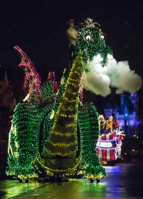 """Pete's Dragon dazzles in the night during the Main Street Electrical Parade at Disneyland Park. The nostalgic fan-favorite Main Street Electrical Parade will once again create magical summer memories for guests of all ages at Disneyland Park, with a limited-time encore engagement taking place nightly, from Aug. 2 – Sept. 30, 2019. The nighttime spectacle features half-million sparkling lights and """"electro-syntho-magnetic musical sounds."""" Disneyland Resort is located in Anaheim, Calif. (Scott Brinegar/Disneyland)"""
