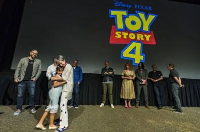 ORLANDO, FLORIDA - JUNE 08: (L-R) Josh Cooley, Jonas Rivera, Annie Potts, Mark Nielsen, Tony Hale, Christina Hendricks, Keanu Reeves, Tom Hanks and Tim Allen surprise fans at an early screening of Pixar's TOY STORY 4 at Disney's Hollywood Studios on June 08, 2019 in Orlando, Florida.
