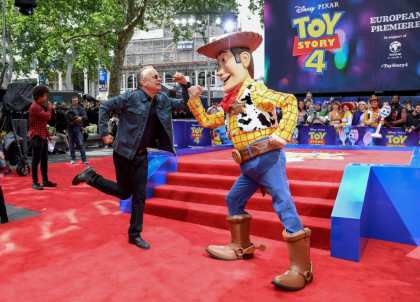 "LONDON, ENGLAND - JUNE 16: Tom Hanks and Woody attend the European premiere of Disney and Pixar's ""Toy Story 4"" at the Odeon Luxe Leicester Square on June 16, 2019 in London, England. (Photo by Gareth Cattermole/Getty Images for Disney and Pixar)"