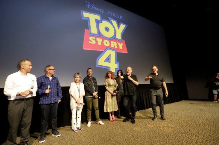 ORLANDO, FLORIDA - JUNE 08: (L-R) Jonas Rivera, Mark Nielsen, Annie Potts, Tom Hanks, Tony Hale, Christina Hendricks, Keanu Reeves and Tim Allen surprise fans at an early screening of Pixar's TOY STORY 4 at Disney's Hollywood Studios on June 08, 2019 in Orlando, Florida. (Photo by John Parra/Getty Images for Disney)